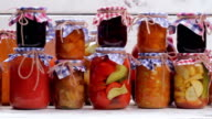 Glass jars with canned products. video