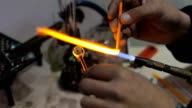 Glass jewelry artist at work video