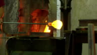 Glass Maker Taking Hot Glass From The Furnace video