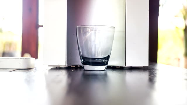 glass of clean water from filter mashine video