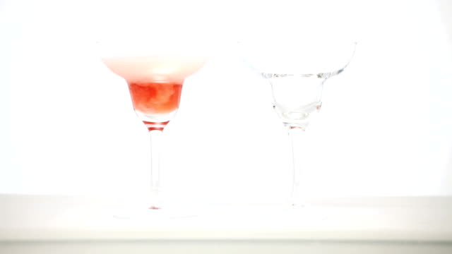 Glass of pink sparkling wine being poured video