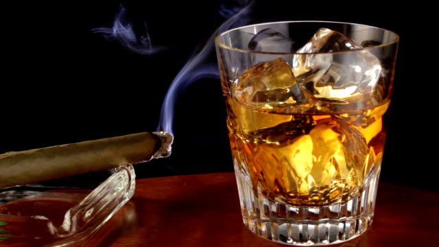 Glass of Whiskey and lit cigar video