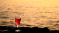 HD DOLLY: Glass Of Wine On The Beach At Sunset video