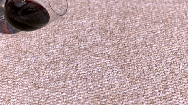 Glass of wine spilling on carpet video