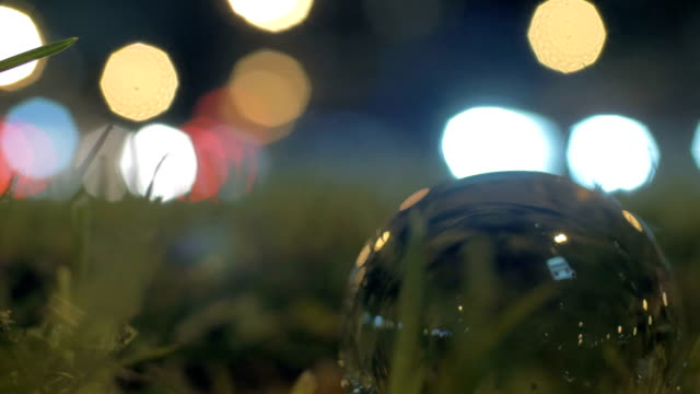 Glass orb and car traffic in the evening video