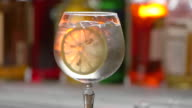 Glass with drink and ice. video