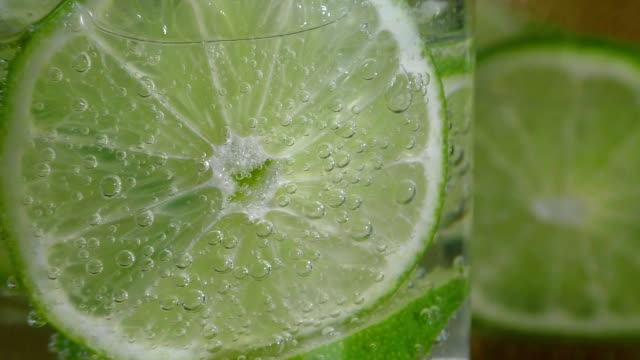 Glass with lime and sparkling water video