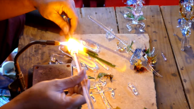 Glassblowing artisan at work in a crystal glass video