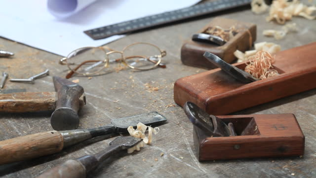 glasses and tools on carpentry table video