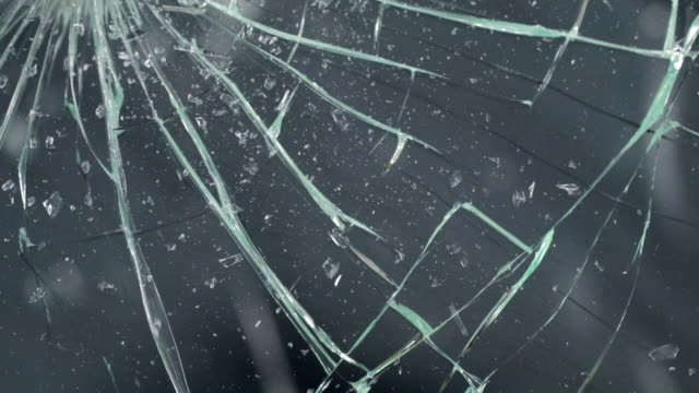 Glass.Smashing real glass into pieces. Cracking and shattering glass video