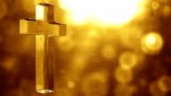Glassy Cross Spin Background Loop - Textured Golden Glow HD video