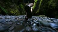 Glide Cam Male Walking Through Creek video