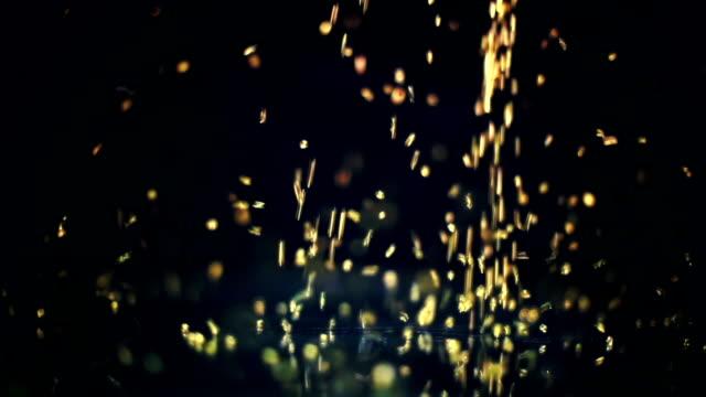Glitter falling on glass seamless loop video