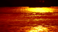 Glittering water during sunset. video