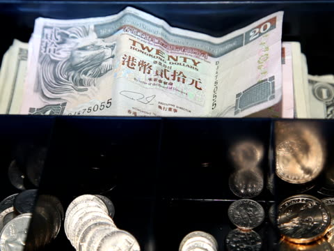 Global Commerce: US Dollars Replace Hong Kong Currency video