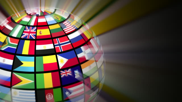 Global communication concept: glowing rotating globe with world flags video