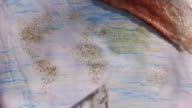 Global map sand-drawing appears video