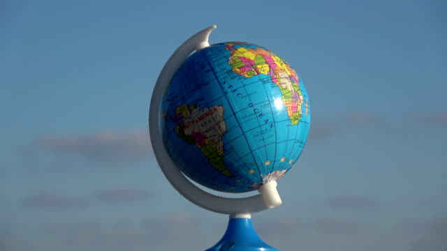 globe sphere map toy rotating on sky background video