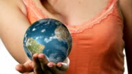Globe spinning in a womans hand video