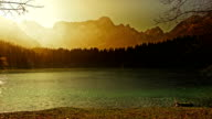 Glorious mountain lake bathing in the golden sunrise video