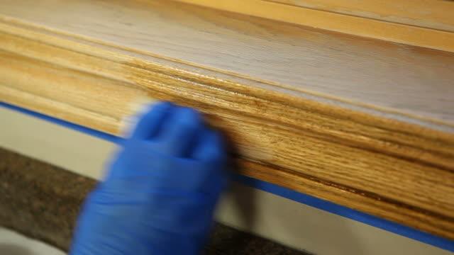 Gloved Hand Staining Oak Window Trim video