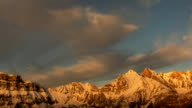glowing alps with moving clouds, time lapse video