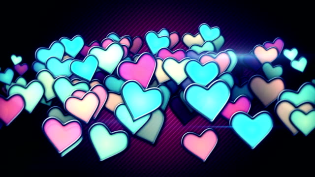 glowing colorful hearts loop background video