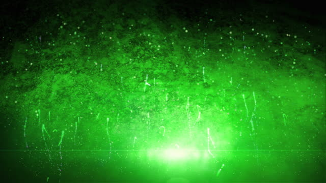 Glowing particles and green backlit video
