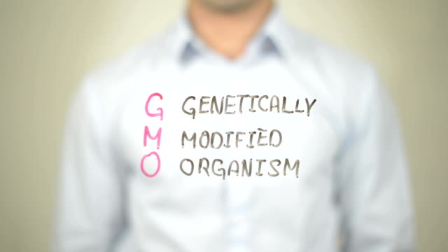 gmo genetically modified organism , Man writing on transparent screen video