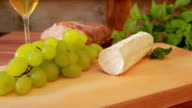 Goat cheese with white wine, grapes and bread video