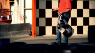 Go-cart racetrack, flag waving, slow motion video