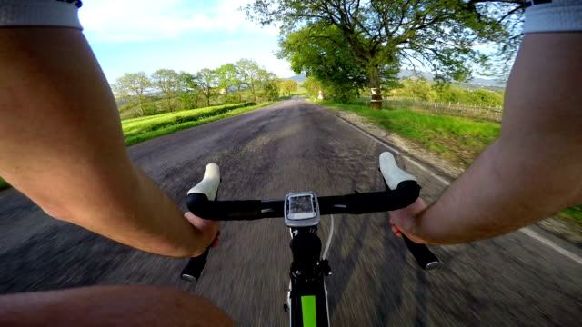 Going Down with Bicycle on the Road pov. video