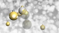 Gold and Silver Christmas ornaments background.  Loopable. video
