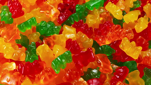 Gold Bears or Gummy Bears turning, Slow Motion video