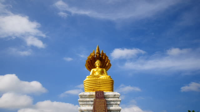 Gold buddha statue in sky background  time lapse video
