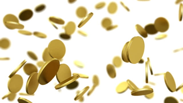 Gold coins falling on white. Looped animation with DOF. video
