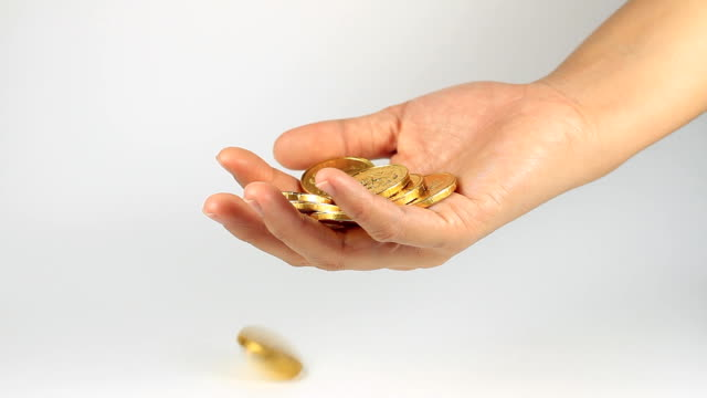 Gold coins on hands of women. video