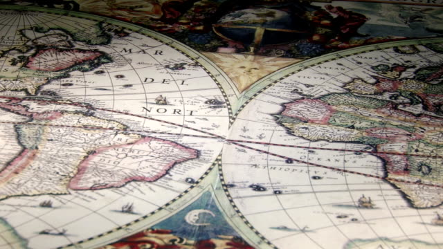 Gold compass, candle, old map, closeup video
