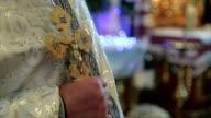gold crucifix in priest hands video