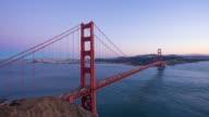 gold gate bridge over sea at sunset. timelapse 4k video