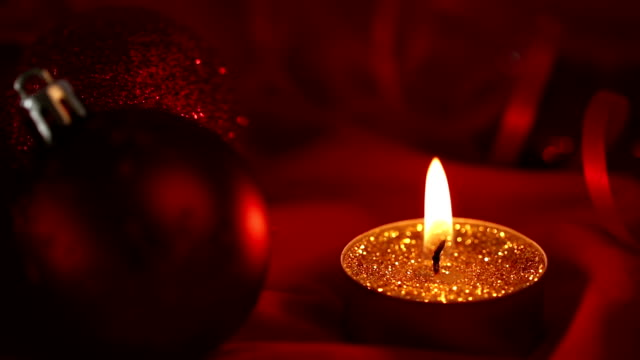 Gold glitter candle flickering beside bauble video