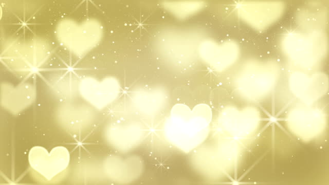 gold heart shapes loop background video