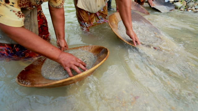 gold panning in a small stream in south of Thailand video