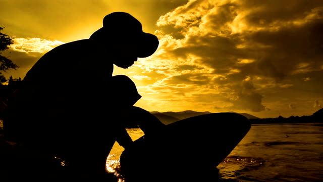 Gold panning in Thailand sunset video