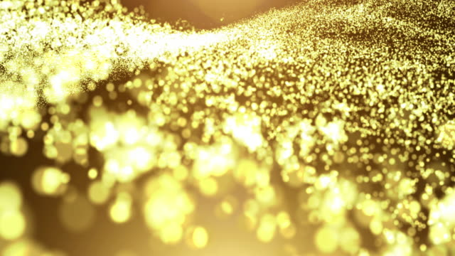 Gold particle wave with light flare video