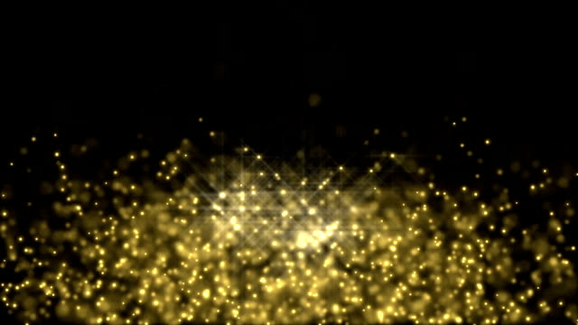 Gold Particles exploding - slow motion video