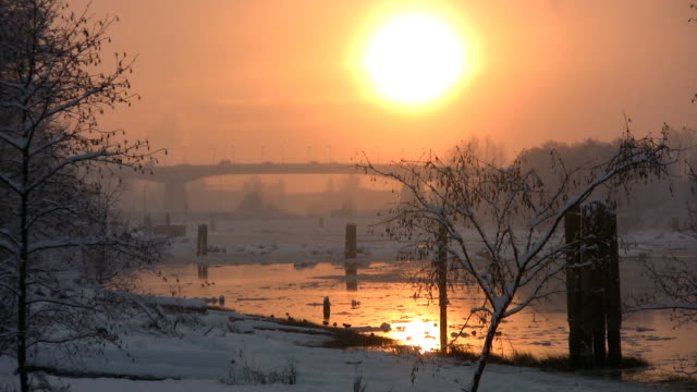 Gold river sunset w/light snow. video