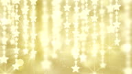 gold shiny hanging stars loop background video