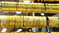 Golden bracelets on window display video