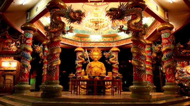 Golden Buddha in Chinese pavilion. video